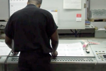 Offset Pressman checking quality