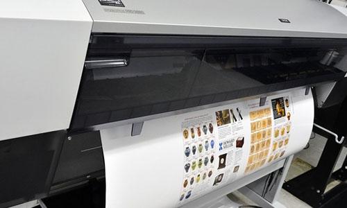 Poster being printed at Kay Printing